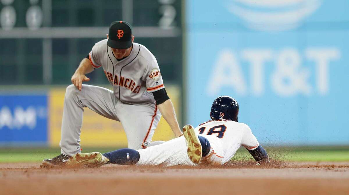 Houston Astros center fielder Tony Kemp (18) is caught stealing second base by San Francisco Giants Kelby Tomlinson during the third inning of an MLB game at Minute Maid Park, Wednesday, May 23, 2018, in Houston.