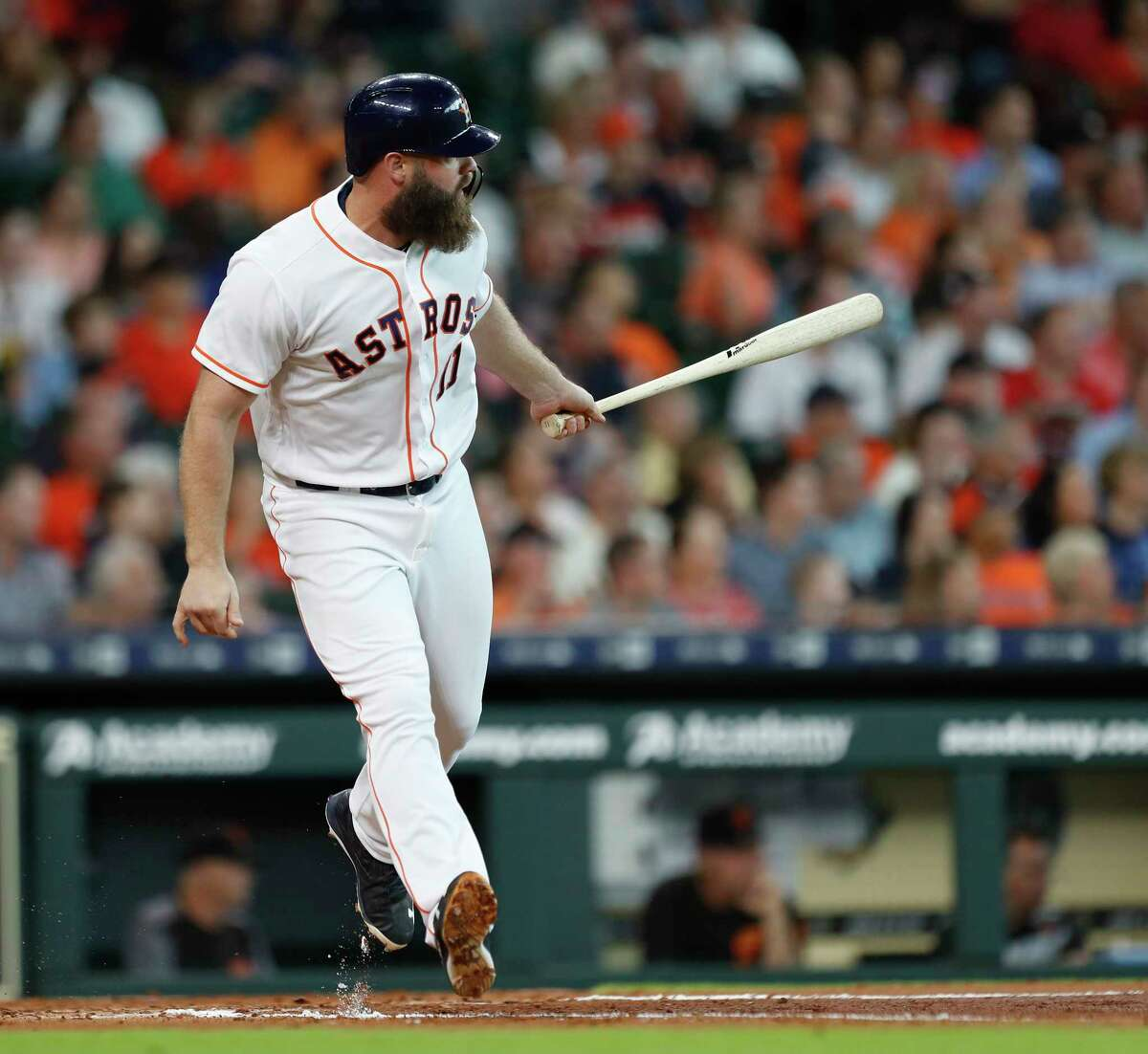 Houston Astros designated hitter Evan Gattis (11) lines out during the third inning of an MLB game at Minute Maid Park, Wednesday, May 23, 2018, in Houston.