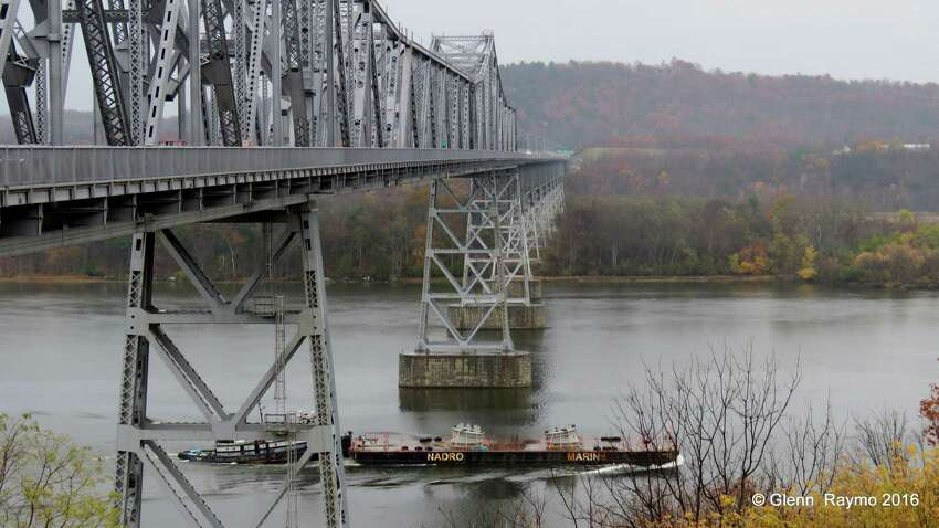 A barge containing pedestals for the new Ferris Wheel on Staten Island sails past the Rip Van Winkle Bridge on Wednesday, Nov. 9, 2016, in Hudson, N.Y. (Courtesy Glenn Raymo)