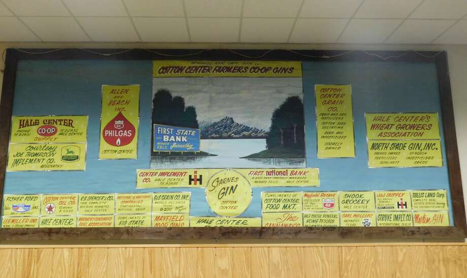 This old stage curtain filled with business advertising from a half-century ago was recently discovered rolled around a pipe and hanging suspended between stage curtains in the Cotton Center School Auditorium. It has since been framed and placed on public display at the rear of the auditorium. Photo: Cotton Center ISD Photo