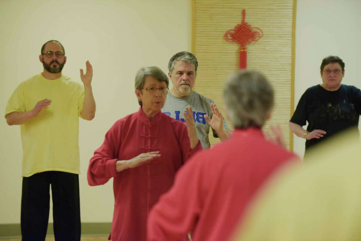 Instructor, Lorraine Noval, in pink, leads a tai chi class that Gary Hahn, Times Union Senior Editor / Features, takes part in at Asian Arts Group on Thursday, May 3, 2018, in Albany, N.Y. (Paul Buckowski/Times Union)