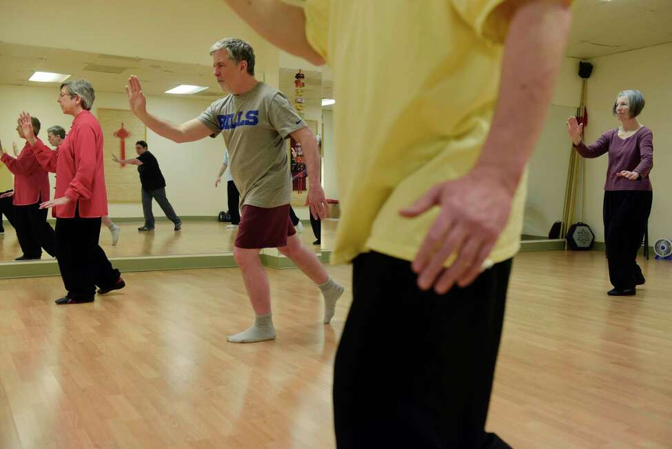 Instructor, Lorraine Noval, far left, leads a tai chi class that Gary Hahn, Times Union Senior Editor / Features, takes part in at Asian Arts Group on Thursday, May 3, 2018, in Albany, N.Y. (Paul Buckowski/Times Union)