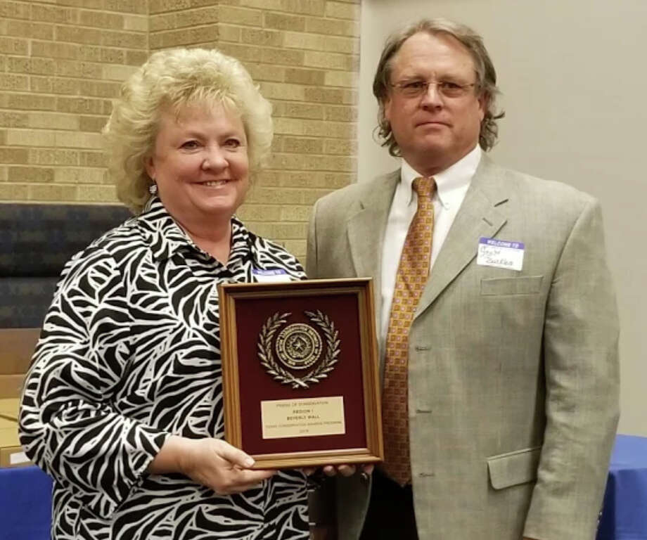 Beverly Wall of Plainview accepts the Area I Friend of Conservation Award from Scott Buckles of Stratford, chairman of the Texas State Soil & Water Conservation Board. She is one of five area finalists for the state award, to be announced later this year. Photo: Courtesy Photo
