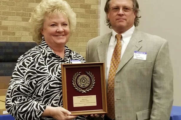 Beverly Wall of Plainview accepts the Area I Friend of Conservation Award from Scott Buckles of Stratford, chairman of the Texas State Soil & Water Conservation Board. She is one of five area finalists for the state award, to be announced later this year.