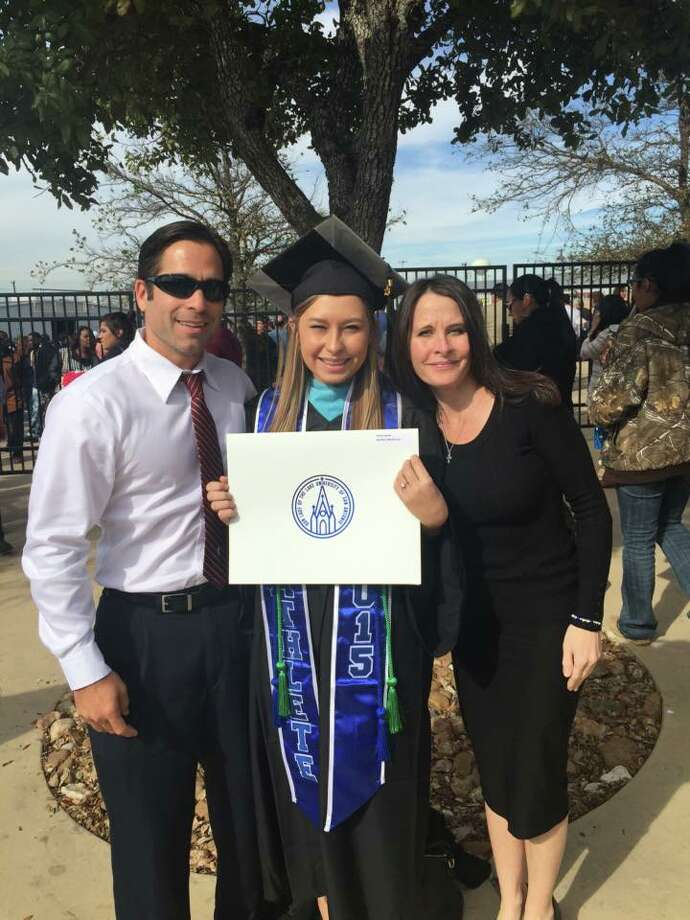 Hailey Reyes poses for a photo with her parents after graduating from Our Lady of the Lake University with a bachelor's degree in psychology. Photo: Facebook/Lisa Garcia