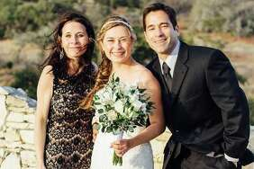Hailey Reyes (center) poses for a photo with her parents, Lisa and Michael Garcia. Reyes and Michael Garcia were shot May 12 at a home in the 700 block of Dogwood Trail in Cedar Park, Texas. Garcia was killed and Reyes was placed on life support.