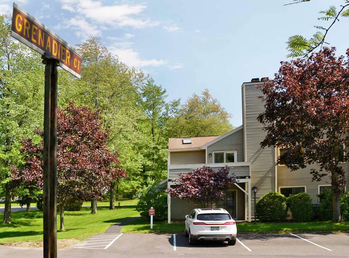 Building No. 7 of the Grenadier Court Condominium complex Wednesday May 23, 2018 in Halfmoon, NY. Unit No. 127 is in the rear of the building. (John Carl D'Annibale/Times Union)