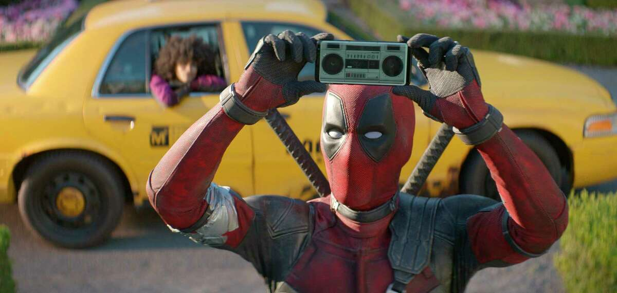 FILE - This image released by Twentieth Century Fox shows Ryan Reynolds in a scene from