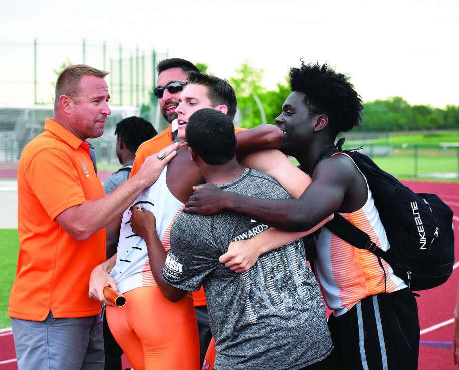 EHS coach Chad Lakatos, left, and members of the track and field team celebrate with Ben Ryan after the 1,600-meter relay team qualified for state.