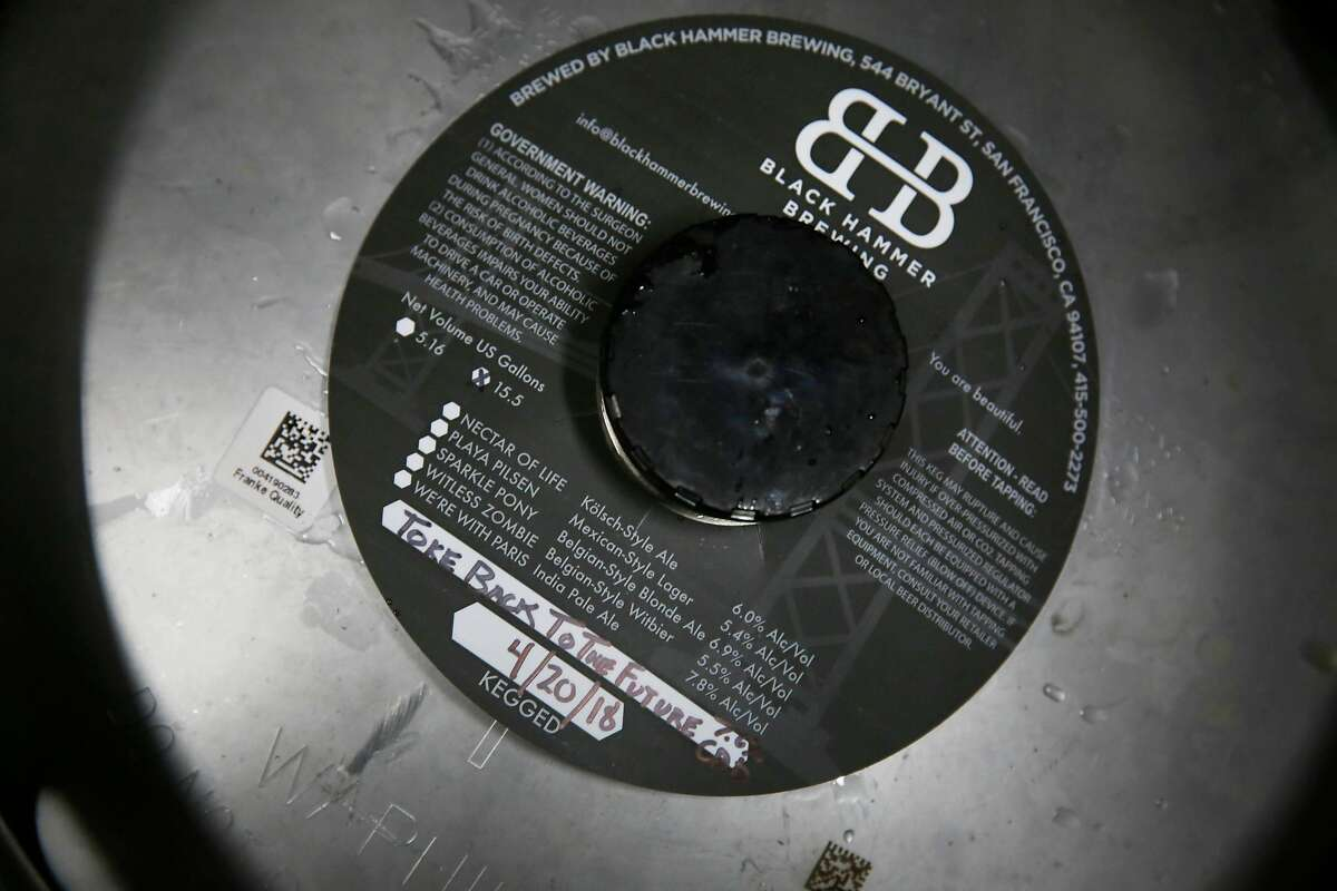 A label for Toke Back to the Future is seen on a keg at Black Hammer Brewing on Wednesday, May 23, 2018 in San Francisco, Calif.