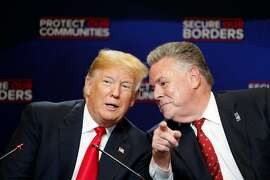 President Donald Trump speaks with Rep.  Peter King (R-N.Y.) during roundtable discussion on immigration and gangs Morrelly Homeland Security Center in Bethpage, N.Y., May 23, 2018. (Tom Brenner/The New York Times)