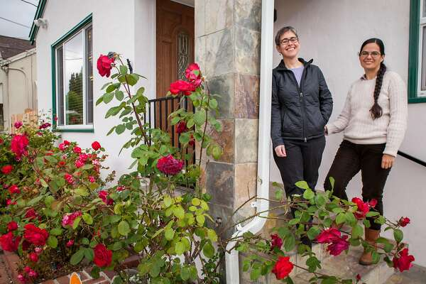 "Stephanie Leveene and her wife Nicol Hammond (l-r) at the new home in Hayward, CA after they moved from San Jose where they sold their condo in a ""off market,"" sale with out an open house to sell it quickly to be able to pay for their new home, Tuesday 22  May 2018 in Hayward, CA. (Peter DaSilva Special to the Chronicle)"