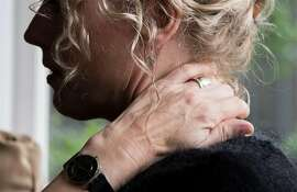 Ann Reidy holds her neck while at her home in Berkeley, Calif. Tuesday, May 15, 2018. Reidy obtained a herniated disc on the night she was sexually assaulted inside her home in 2015.