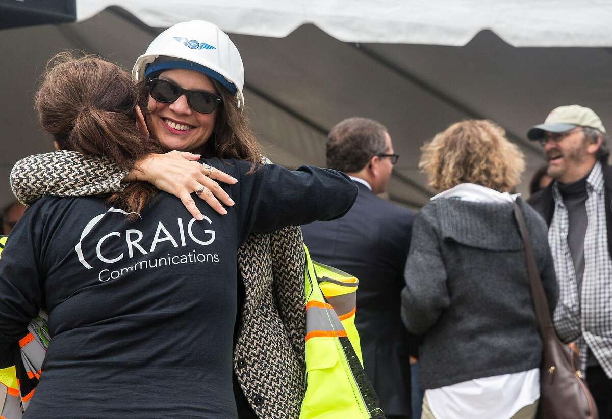 Alameda Mayor Trish Herrera Spencer hugs a colleague during the groundbreaking ceremony for the future site of Alameda Point Site A, a $1 billion waterfront development project at Alameda Point in Alameda, Calif. Wednesday, May 23, 2018.