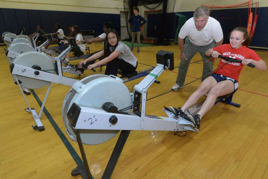 Norwalk River Rowing Association Executive Director Jeff Thompson encourages Sophmore Ali Mills on the rowing machine as Brien McMahon High School holds its first wellness week Wednesday, May 23, 2018, in Norwalk, ls Conn. The Future Project Wellness Workshops offered Vegetable Gardening Mind & Body Self Soothing, Wellness Jeopardy and River Rowing as well as Yoga and Aroma Therapy. Photo: Erik Trautmann / Hearst Connecticut Media / Norwalk Hour