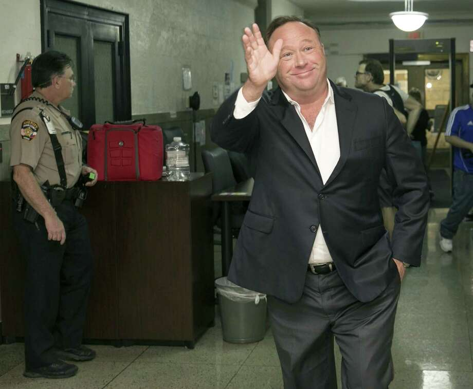 Alex Jones, a right-wing radio host and conspiracy theorist, arrives for a child custody trial at the Heman Marion Sweatt Travis County Courthouse in Austin, Texas, on Wednesday April 19, 2017. (Jay Janner/Austin American-Statesman via AP) Photo: Jay Janner / Associated Press / Stratford Booster Club