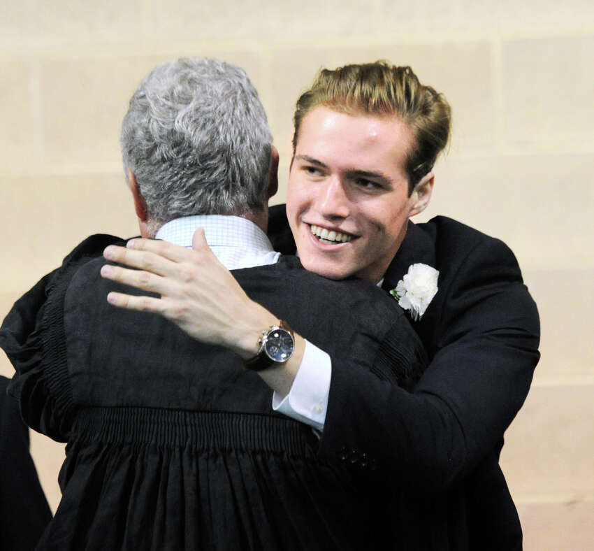Graham Pierce, 18, of Greenwich, received a hug during his Brunswick School commencement in the Dann Gymnasium at the school in Greenwich, Conn., Wednesday, May 23, 2018. Pierce said he will be attending Santa Clara University in the fall. Ninety-nine students graduated.