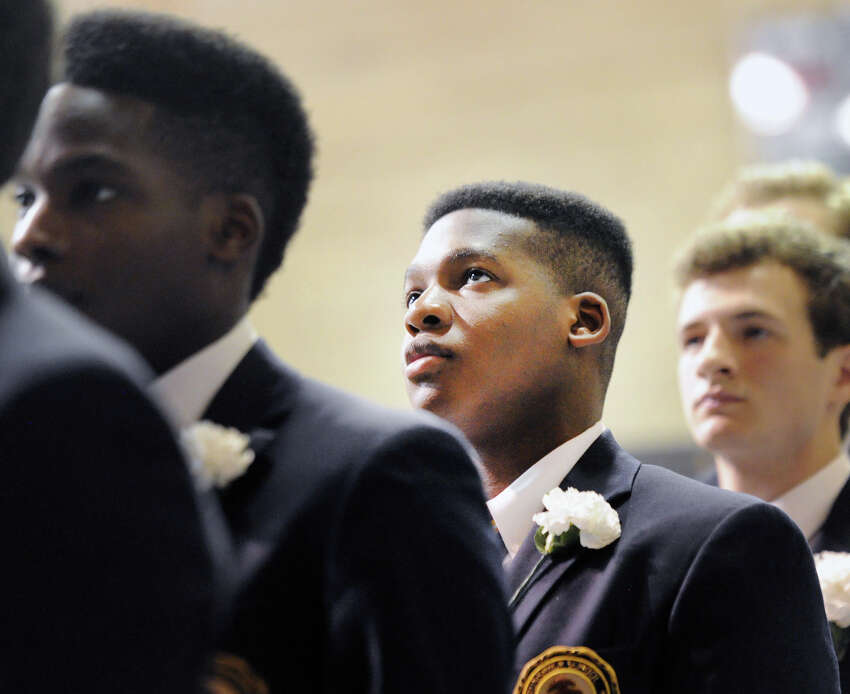 Eromosei Daniel Osemobor, 18, of Stamford, during his Brunswick School commencement in the Dann Gymnasium at the school in Greenwich, Conn., Wednesday, May 23, 2018. Osemobor said he will be attending Washington University in St. Louis and will be studying to become a medical doctor. Ninety-nine students graduated.