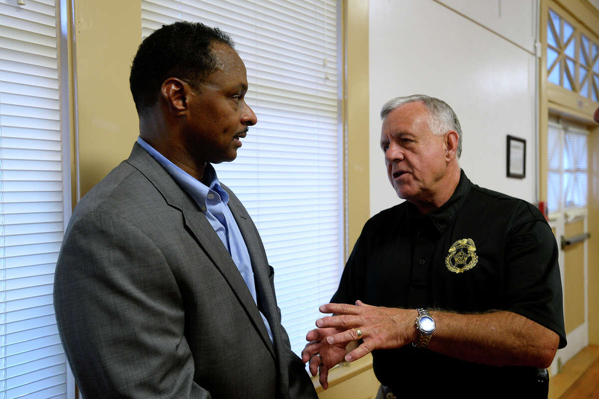 Arthur Barclay, left, talks with deputy chief John Owens at a community forum for the finalists for the Port Arthur police chief job opening on Wednesday evening. Barclay is a Port Arthur native and a finalist for the job. Photo taken Wednesday 9/14/16 Ryan Pelham/The Enterprise