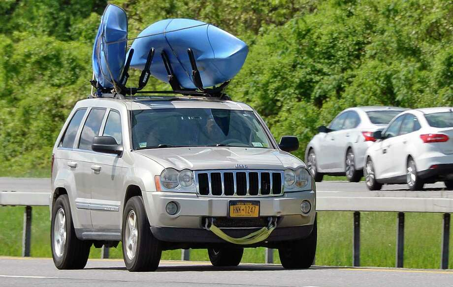 A kayak loaded Jeep makes its way up the Northway Wednesday May 23, 2018 in Clifton Park, NY. (John Carl D'Annibale/Times Union) Photo: John Carl D'Annibale / 20043858A