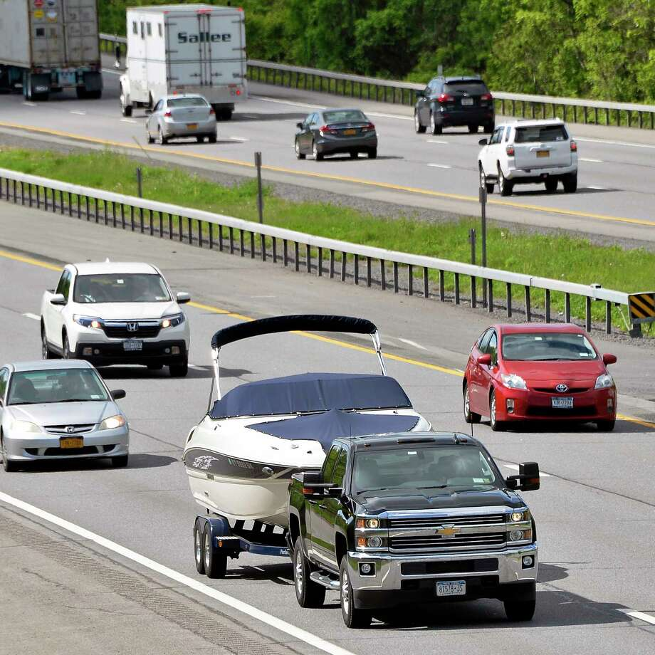 Traffic was slow on the Northway Friday after a car caught fire near Exit 8 in Halfmoon. In this photo, a pick-up truck tows a boat up the Northway Wednesday May 23, 2018 in Clifton Park, NY. (John Carl D'Annibale/Times Union) Photo: John Carl D'Annibale / 20043858A