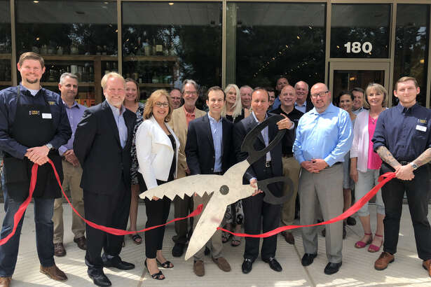 Twin Liquors owners and representatives cut the ribbon on the new Kingwood store on Wednesday, May 23, 2018.
