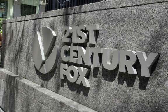 Comcast says its considering making an offer to buy Twenty-First Century Fox, which would put it in a head-to-head bidding fight with Disney.