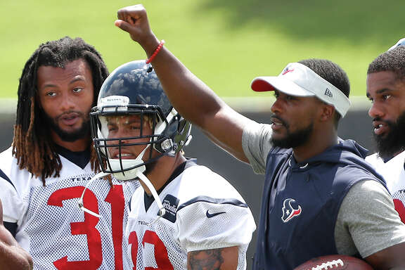 Newcomer Tyrann Mathieu, center, already has made his presence felt during the Texans' organized team activities.
