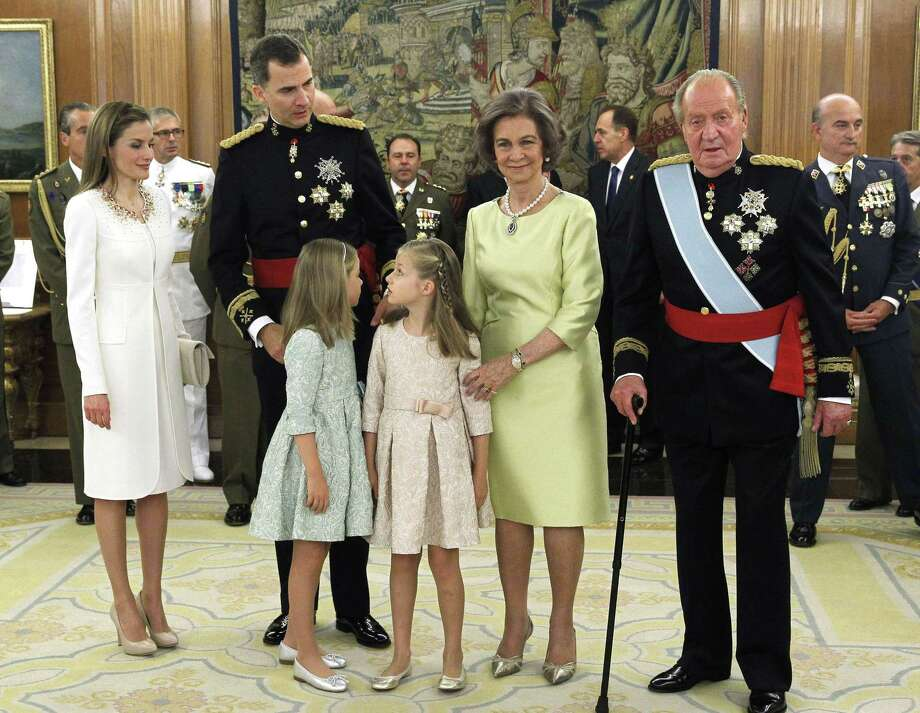 Spain's Queen Letizia, (from left) Spain's King Felipe VI, Spanish Princess Sofia, Spanish Crown Princess of Asturias Leonor, Spain's former Queen Sofia and Spain's former King Juan Carlos stand during a handing-over ceremony for the sash of the Capitain General in the Chamber of Audiences at the Zarzuela Palace. Spain's King Felipe VI began his reign in 2014. Photo: ZIPI /AFP /Getty Images / AFP