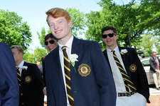 At left, Henry Rogers, 18, of Greenwich, smiles during his Brunswick School commencement in the Dann Gymnasium at the school in Greenwich, Conn., Wednesday, May 23, 2018. Ninety-nine students graduated. Rogers said he will be attending the University of Colorado Boulder in the fall.