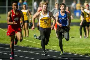 Coleman sophomore Austin Lumbert competes in the 100-meter dash during a track and field meet on Wednesday, May 23, 2018 at Coleman High School. (Katy Kildee/kkildee@mdn.net)