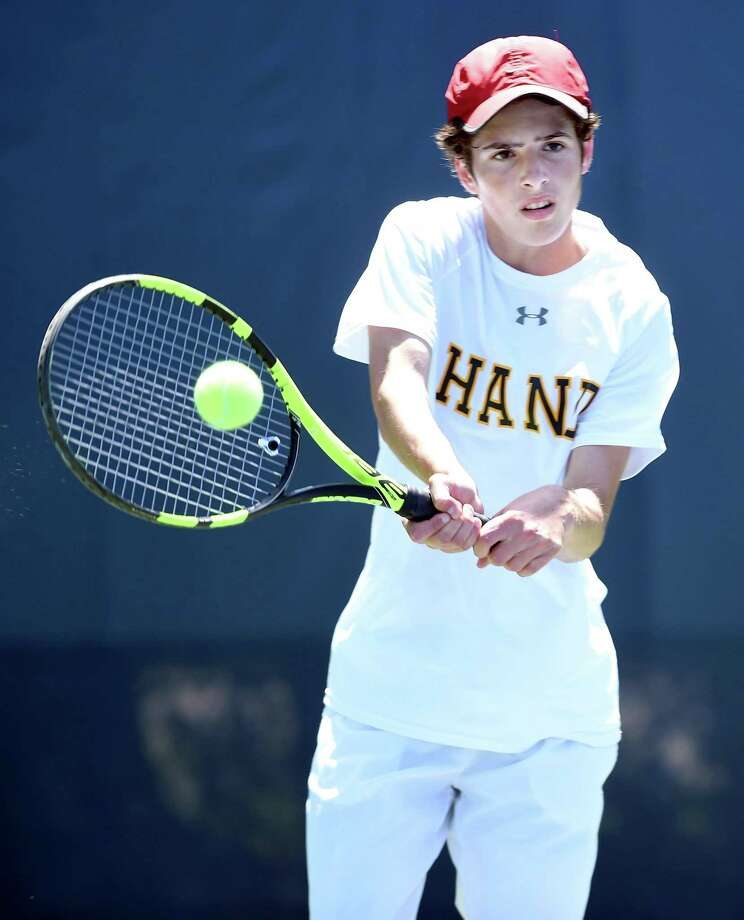 Justin Pace of Daniel Hand hits a backhand to Brett Gloria of Amity Regional in the SCC Boys/Girls Tennis Championship at Yale University in New Haven on May 23, 2018. Photo: Arnold Gold / Hearst Connecticut Media / New Haven Register
