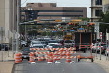 Traffic backs up near downtown Midland while the southbound lanes of Big Spring Street are closed the evening of May 23, 2018 while City of Midland employees work to repair a major water leak. James Durbin/Reporter-Telegram