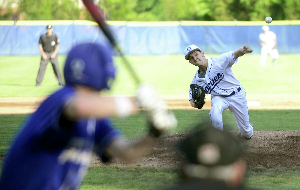 Darien Justin Jordan (8) delivers during a FCIAC baseball semifinal game at Cubea pitch in the first inning to Fairfield Ludlowe Derek Tallman (1) in an FCIAC Baseball game at Cubeta Stadium in Stamford, Conn. on May 23, 2017. Darien defeated Fairfield Ludlowe 2-0.