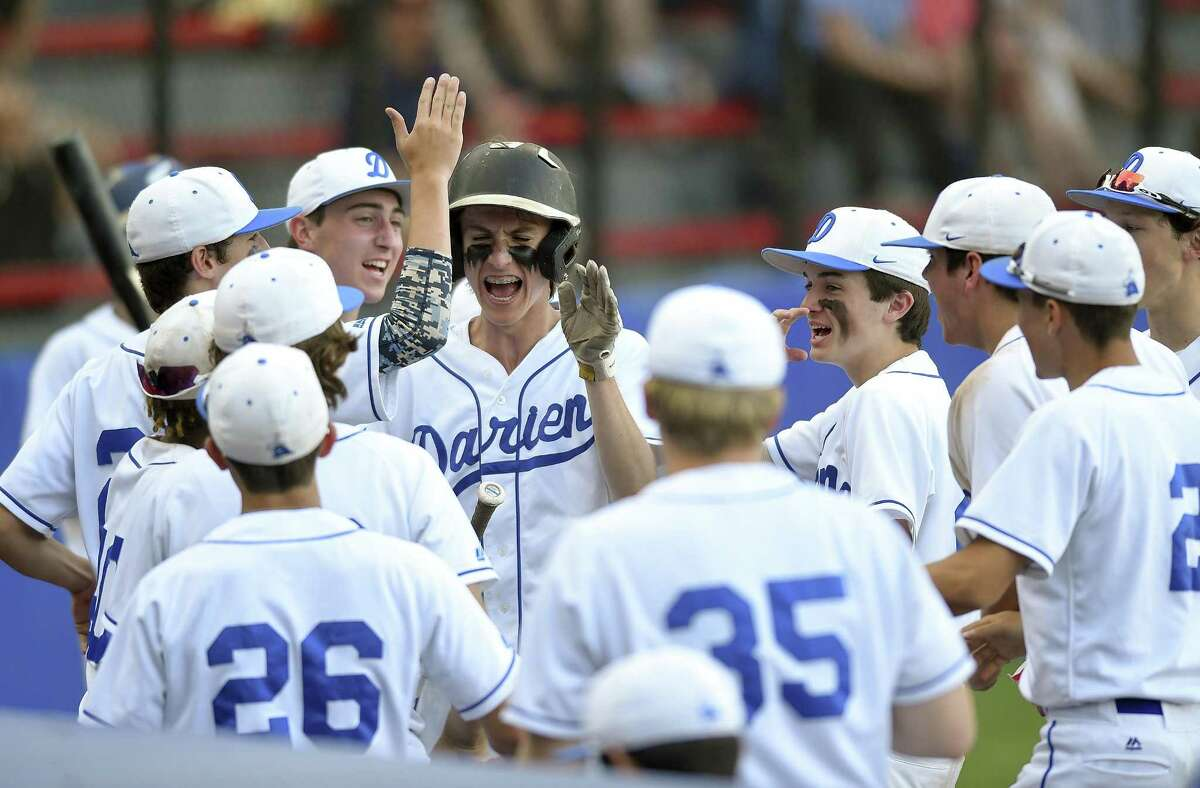 Darien's Fin Batson, center, celebrates scoring off a single by Arthur Xanthos in the third inning during a FCIAC baseball semifinal game against Ludlowe.