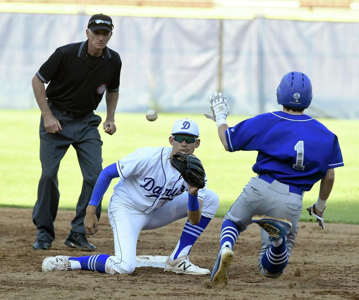 Darien's Henry Williams (11) waits for the throw to tag Fairfield Ludlowe's Derek Tallman trying to advance the bases during a FCIAC baseball semifinal game at Cubeta Stadium in Stamford, Conn. on May 23, 2017. Darien defeated Fairfield Ludlowe 2-0.