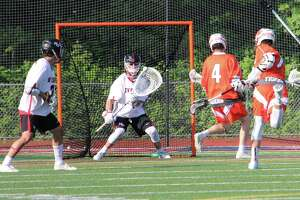 Ridgefield's Greg Gatto fires a shot during the FCIAC boys lacrosse semifinals at Brien McMahon High School in Norwalk, Conn. on May 23, 2018. No. 2 New Canaan defeated No. 3 Ridgefield 10-6.