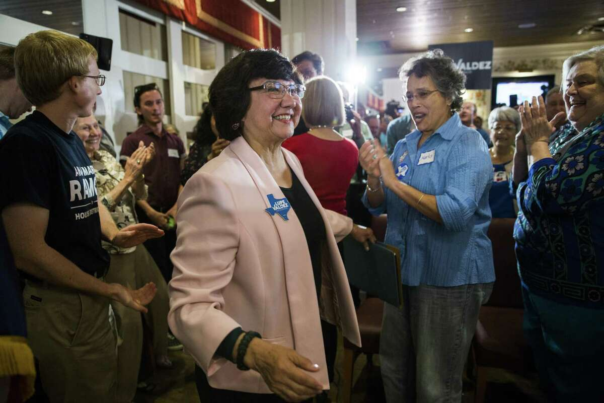 After securing the Democratic nomination for Texas governor, former Dallas County Sheriff Lupe Valdez makes her way to a podium at Ellen's in Dallas on Tuesday, May 22, 2018.