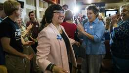 Gubernatorial candidate and former Dallas County Sheriff Lupe Valdez makes her way to a podium after her runoff win at a democratic party celebration at Ellen's in Dallas on Tuesday, May 22, 2018. Today's primary runoff election will decide whether Valdez or Andrew White will be the democratic candidate for Texas governor on the ballot in November. (Ashley Landis/The Dallas Morning News)