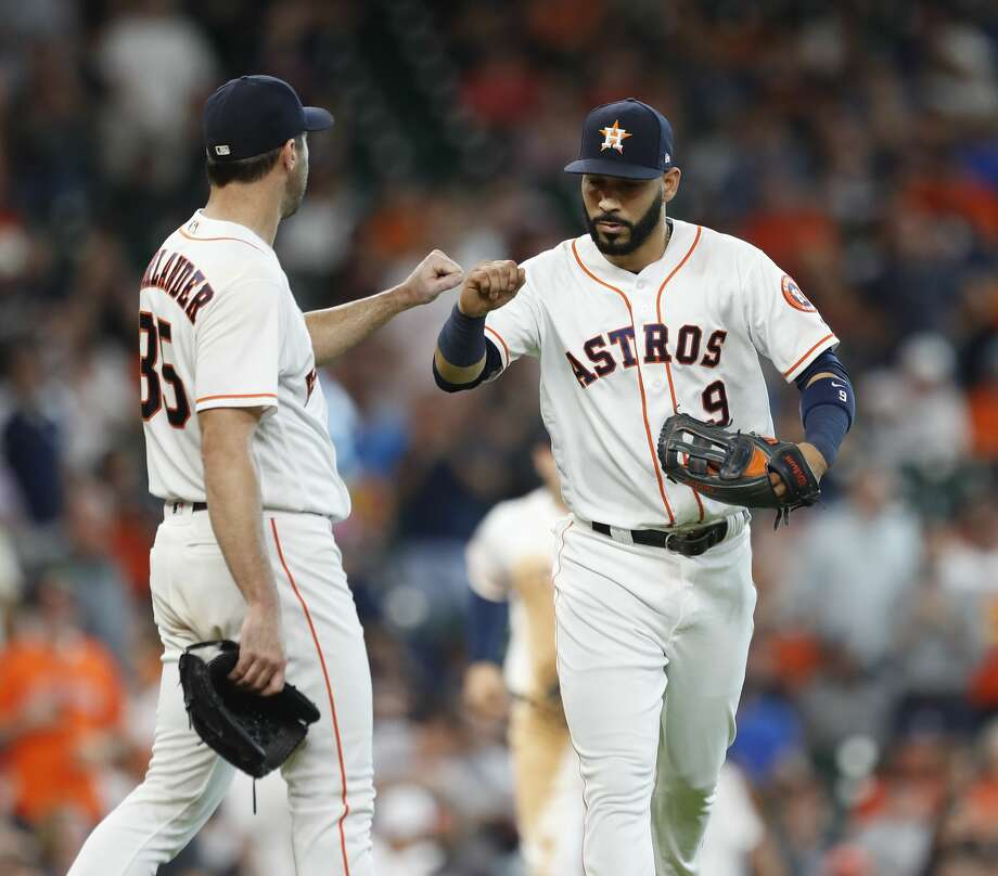 Houston Astros starting pitcher Justin Verlander (35) celebrates wth  left fielder Marwin Gonzalez (9) after he caught San Francisco Giants Brandon Belt's flyout behind his back in foul territory during the sixth inning of an MLB game at Minute Maid Park, Wednesday, May 23, 2018, in Houston.  ( Karen Warren  / Houston Chronicle ) Photo: Karen Warren/Houston Chronicle