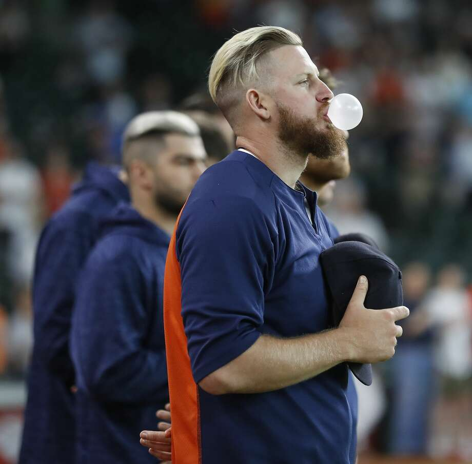 Houston Astros relief pitcher Chris Devenski (47) blows a bubble during the National Anthem before the start of an MLB game at Minute Maid Park, Wednesday, May 23, 2018, in Houston.  ( Karen Warren  / Houston Chronicle ) Photo: Karen Warren/Houston Chronicle