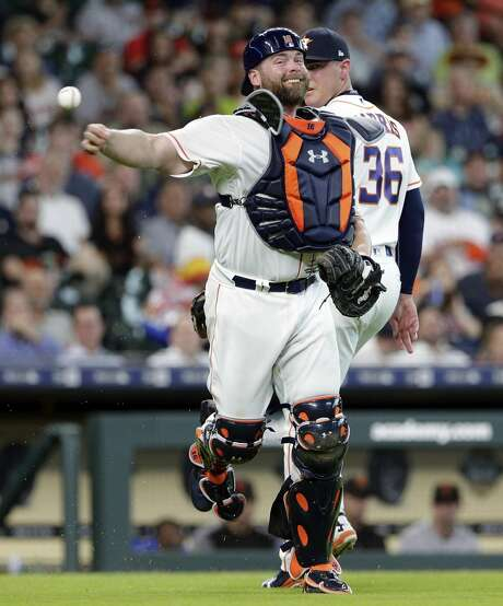 Houston Astros catcher Brian McCann (16) attempts the throw to first base on the infield hit by San Francisco Giants Brandon Crawford that deflected off of Houston Astros relief pitcher Will Harris (36) during the seventh inning of a baseball game Wednesday, May 23, 2018, in Houston. (AP Photo/Michael Wyke) Photo: Michael Wyke/Associated Press