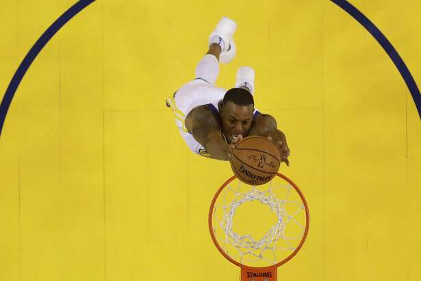 Golden State Warriors' Andre Iguodala goes up for a dunk against the Houston Rockets during the first half in Game 3 of the NBA basketball Western Conference Finals Sunday, May 20, 2018, in Oakland, Calif. (AP Photo/Marcio Jose Sanchez)