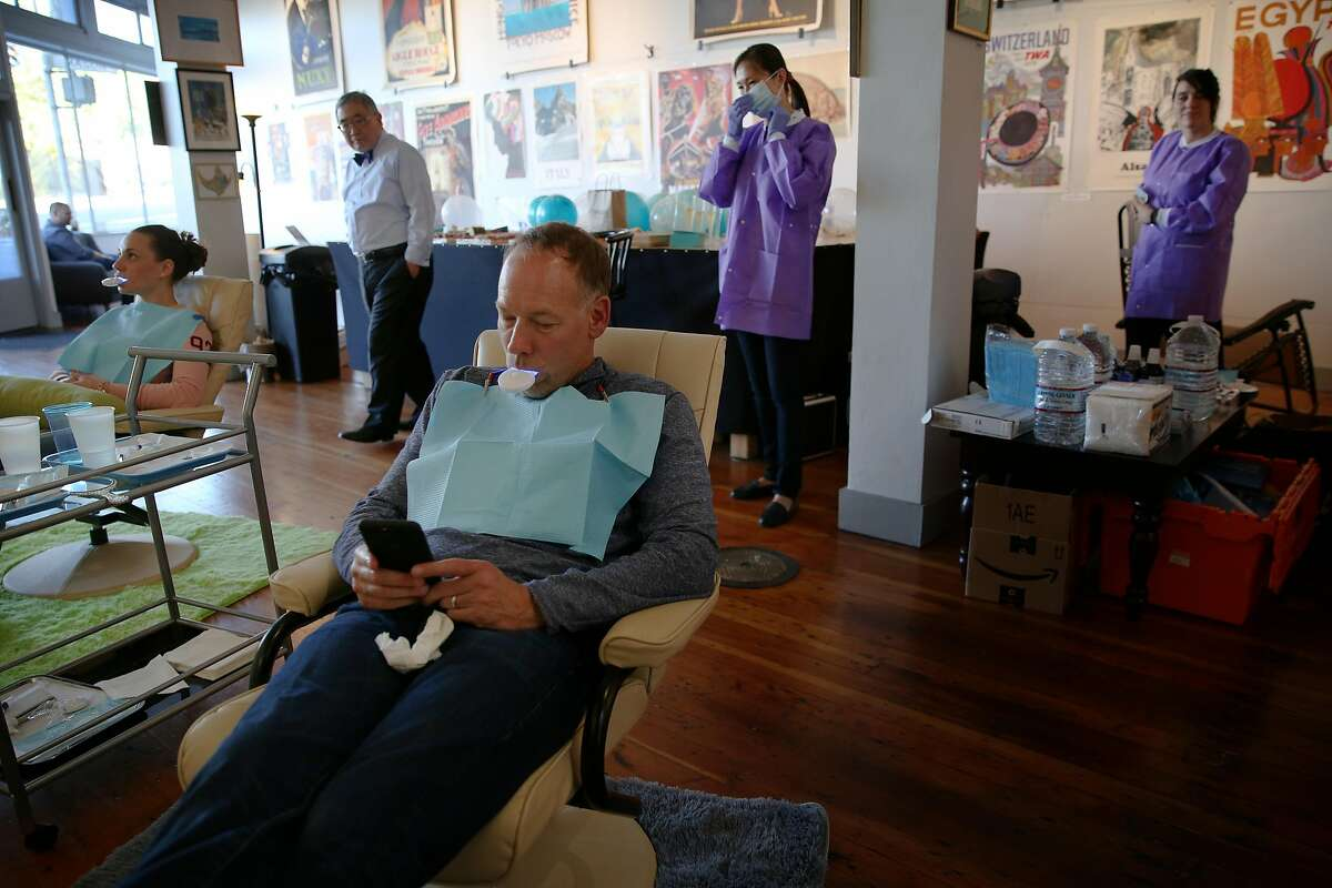 Perry K. during a teeth whitening session at Dazzle Bar, Friday, May 11, 2018, in San Francisco, Calif. Dazzle Bar, a pop-up breath freshening and teeth whitening service, was held at the Real Old Paper Gallery in the North Beach neighborhood.