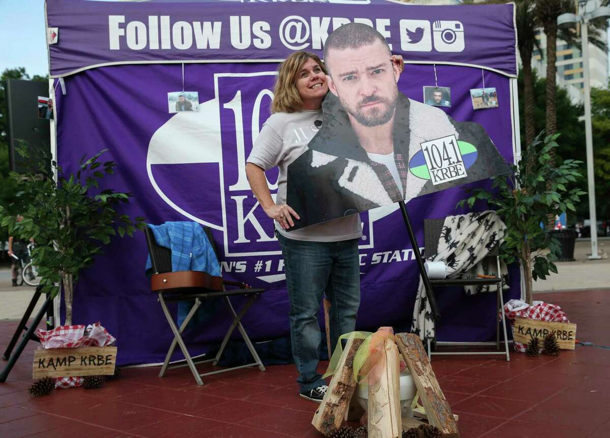 Fans taking photographs with a Justin Timberlake cutout board before the