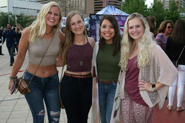 """Fans pose for a photograph before Justin Timberlake """"The Man of the Woods"""" tour at Toyota Center on Wednesday, May 23, 2018, in Houston."""