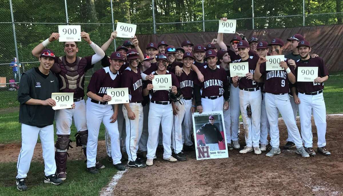 North Haven baseball players celebrate with coach Bob DeMayo after the Indians defeated Amity 7-6 on Wednesday, May 23, 2018 that earned DeMayo his 900th career victory.