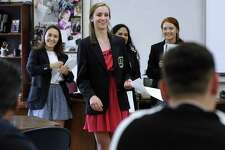 Members of the Danbury High School DECA team, from leftCatarina Silva, 17, Caitlin Ansel 18, Amandha DeSouza, 18 and Courtney Capozzi, 17, give a presentation about Danbury High school  and its new addition to local Realtors for what they're calling Realtor Day, Wednesday, May 23, 2018.