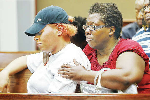Family and friends of the two men slain late Monday in Alton Acres were emotional Wednesday as Police announced charges against a 35-year-old Alton man taken into custody by the ILEAS tactical team early Wednesday morning in Alton.