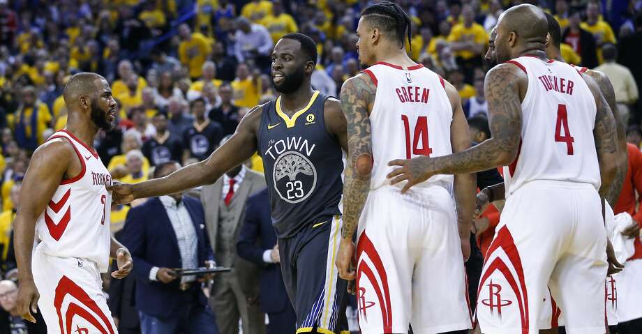 Houston Rockets guard Chris Paul (3), guard Gerald Green (14)] and forward PJ Tucker (4) surround Golden State Warriors forward Draymond Green (23) during the first half of Game 4 of the Western Conference Finals at Oracle Arena Tuesday, May 22, 2018 in Oakland. (Michael Ciaglo / Houston Chronicle) Photo: Michael Ciaglo/Houston Chronicle
